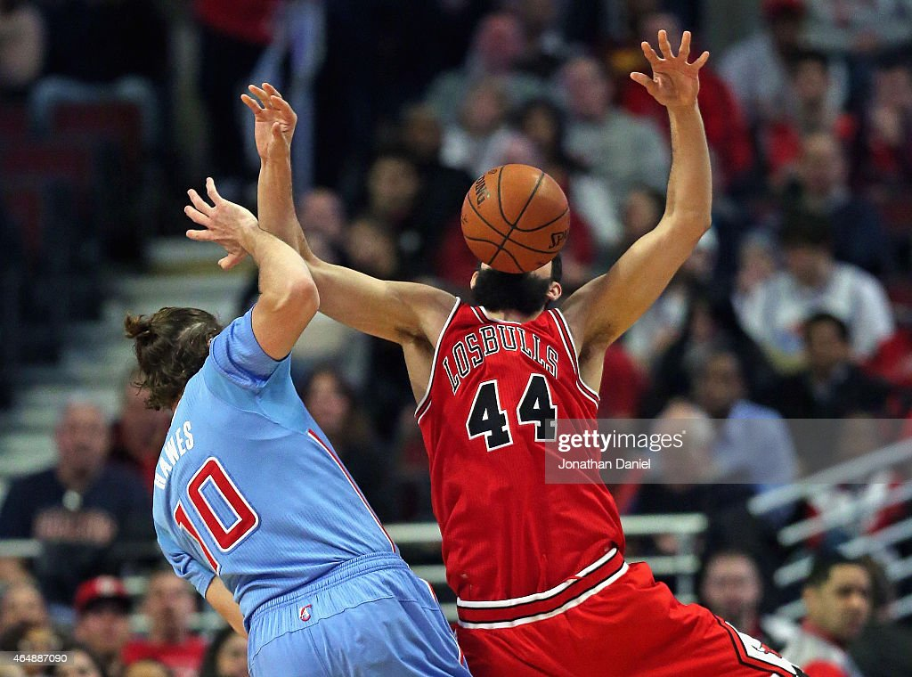 Nikola Mirotic #44 of the Chicago Bulls looses the ball after being fouled by Spencer Hawes #10 of the Los Angeles Clippers at the United Center on March 1, 2015 in Chicago, Illinois.