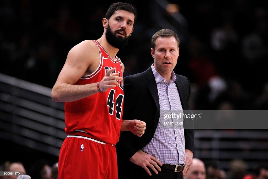 Nikola Mirotic of the Chicago Bulls meets with head coach
