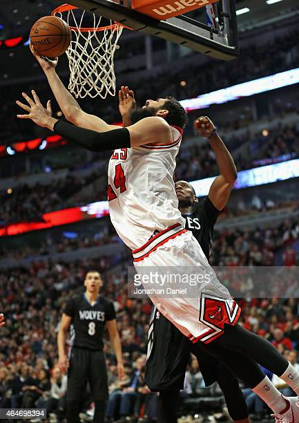 Nikola Mirotic of the Chicago Bulls puts up a reverse layup against the Minnesota Timberwolves at the United Center on February 27 2015 in Chicago...