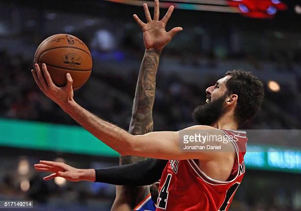 Nikola Mirotic of the Chicago Bulls puts up a shot past of Derrick Williams of the New York Knicks on hi s way to a game and career high 35 points at...