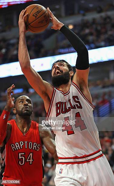 Nikola Mirotic of the Chicago Bulls puts up a shot past Patrick Patterson of the Toronto Raptors on his way to a gamehigh 29 points at the United...