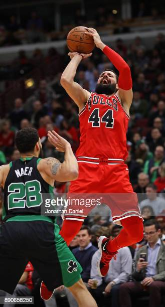Nikola Mirotic of the Chicago Bulls shoots over Abdel Nader of the Boston Celtics on his way to a gamehigh 24 points at the United Center on December...
