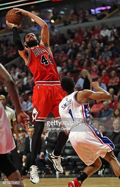 Nikola Mirotic of the Chicago Bulls shoots over Ish Smith of the Philadelphia 76ers on his way to a gamehigh 32 points at the United Center on April...