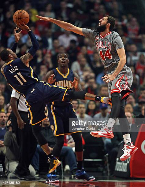 Nikola Mirotic of the Chicago Bulls tries to block a shot by Monta Ellis of the Indiana Pacers at the United Center on November 16, 2015 in Chicago,...
