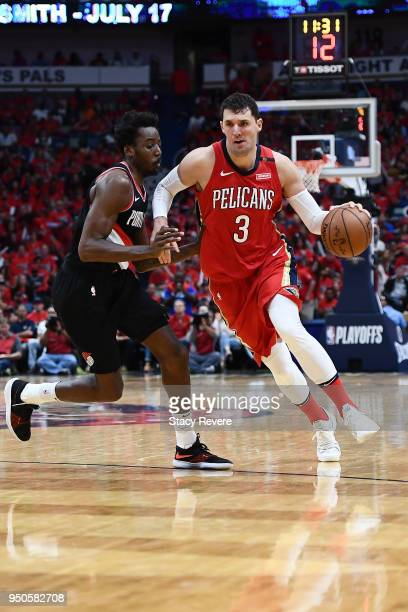 Nikola Mirotic of the New Orleans Pelicans drives to the basket against AlFarouq Aminu of the Portland Trail Blazers during Game Four of the first...