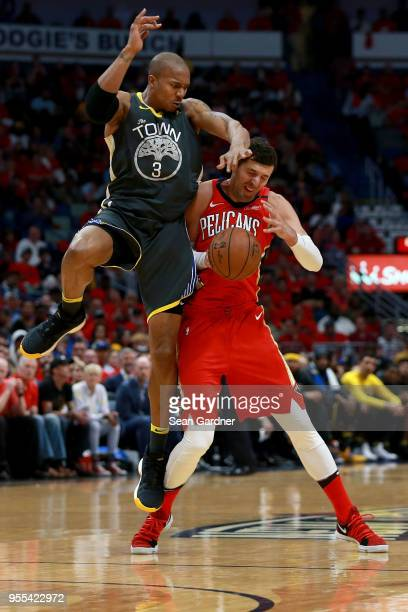 Nikola Mirotic of the New Orleans Pelicans is fouled by David West of the Golden State Warriors during the first half of Game Four of the Western...