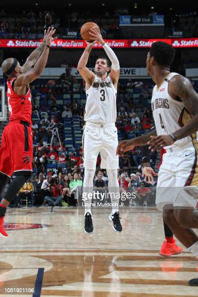Nikola Mirotic of the New Orleans Pelicans shoots a three point basket against the Toronto Raptors during a preseason game on October 11 2018 at...