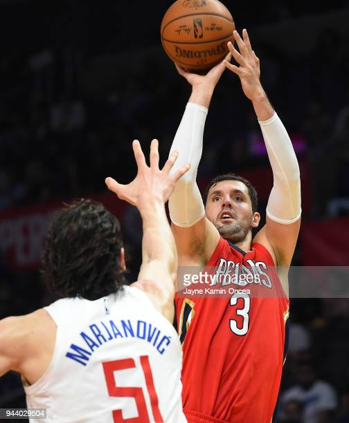 Nikola Mirotic of the New Orleans Pelicans shoots against Boban Marjanovic of the Los Angeles Clippers in the second half of the game at Staples...