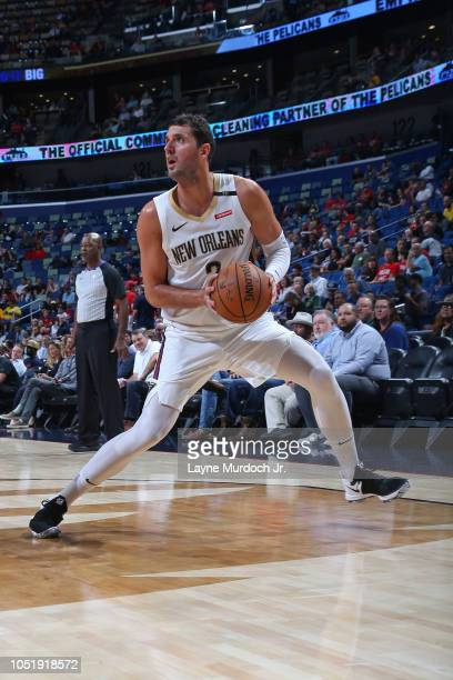 Nikola Mirotic of the New Orleans Pelicans steps back to shoot a three point basket against the Toronto Raptors during a preseason game on October 11...