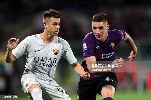 Nikola Mllenkovic of ACF Fiorentina struggles with Stephan El Shaarawy of AS Roma during the Serie A match between ACF Fiorentina and AS Roma at...