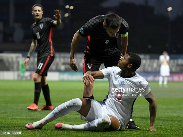 Nikola Moro of Croatia stands over Rhian Brewster of England during the 2021 UEFA European Under-21 Championship Group D match between Croatia and...