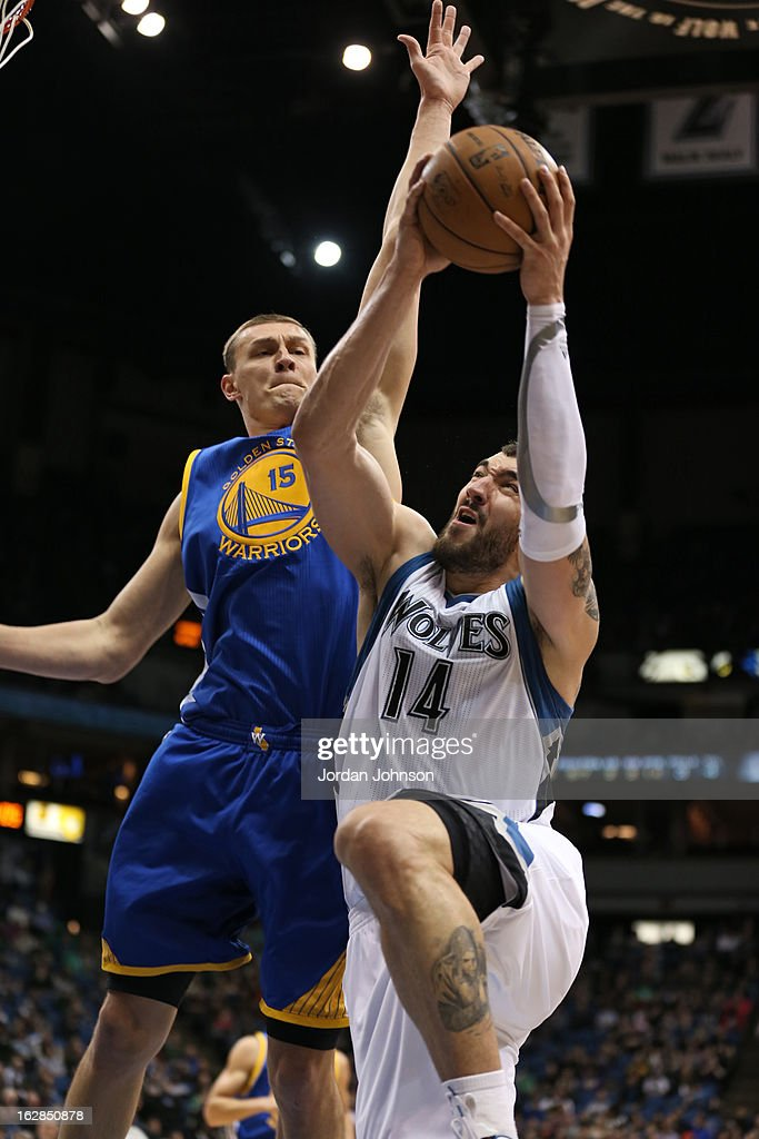 Nikola Pekovic #14 of the Minnesota Timberwolves drives to the basket against the Golden State Warriors on February 24, 2013 at Target Center in Minneapolis, Minnesota.