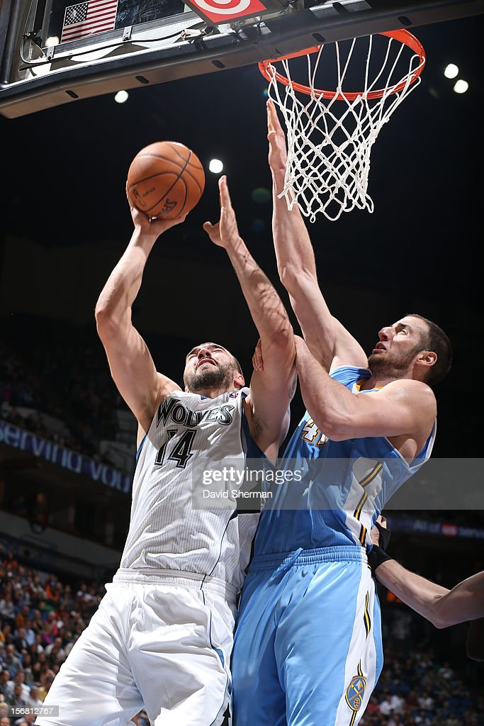 Nikola Pekovic #14 of the Minnesota Timberwolves goes to the basket against Kosta Koufos #41 of the Denver Nuggets during the game between the Minnesota Timberwolves and the Denver Nuggets on November 21, 2012 at Target Center in Minneapolis, Minnesota.