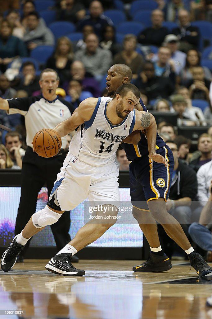 Nikola Pekovic #14 of the Minnesota Timberwolves handles the ball against David West #21 of the Indiana Pacers on November 9, 2012 at Target Center in Minneapolis, Minnesota.