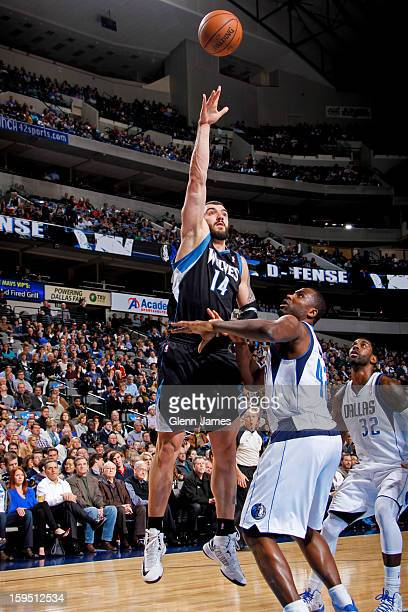 Nikola Pekovic of the Minnesota Timberwolves puts up a hook shot against Elton Brand of the Dallas Mavericks on January 14 2013 at the American...