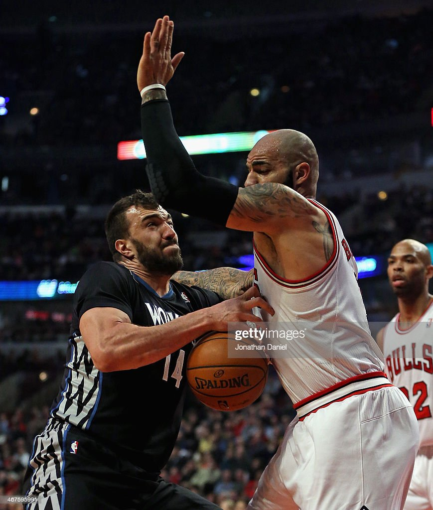 Nikola Pekovic #14 of the Minnesota Timberwolves runs into Carlos Boozer #5 of the Chicago Bulls at the United Center on January 27, 2014 in Chicago, Illinois.