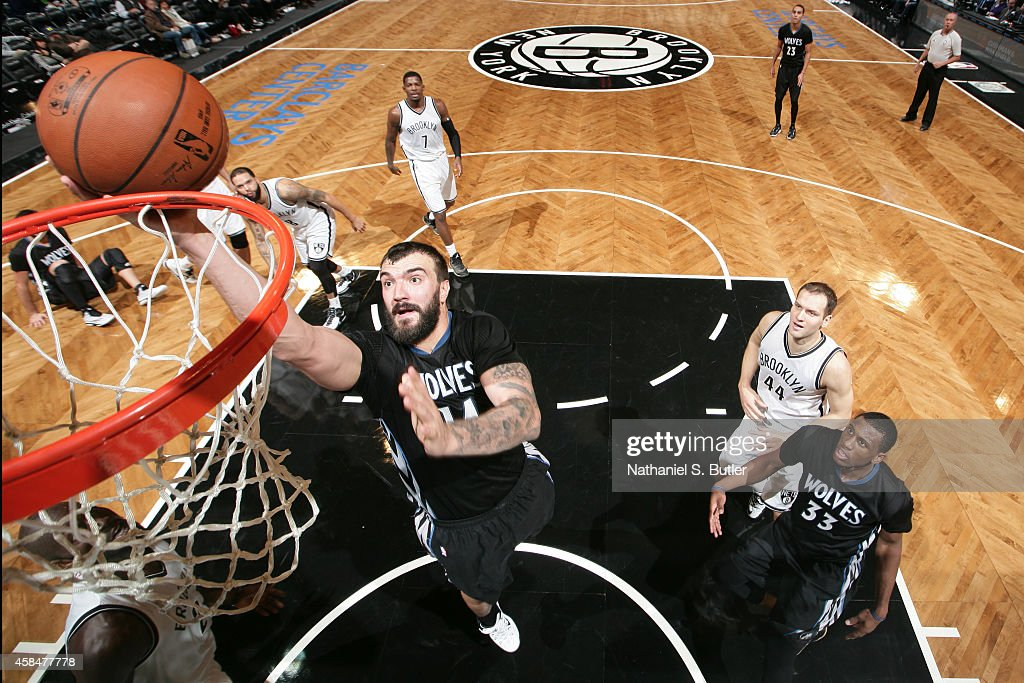 Nikola Pekovic #14 of the Minnesota Timberwolves shoots the ball against the Brooklyn Nets during the game on November 5, 2014 at Barclays Center in Brooklyn, New York.