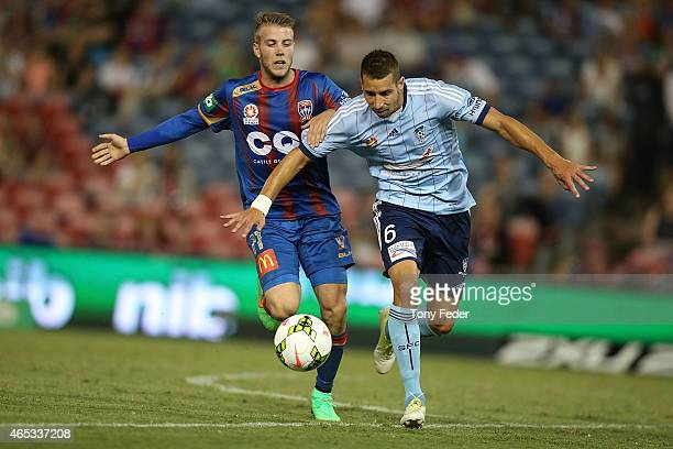 Nikola Petkovic of Sydney FC and Andrew Hoole of the Jets contest the ball during the round 20 ALeague match between the Newcastle Jets and Sydney FC...
