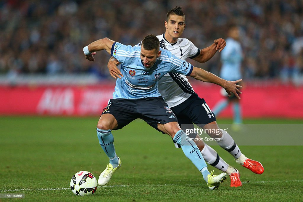 Nikola Petkovic of Sydney FC and Erik Lamela of Hotspur contest the ball during the international friendly match between Sydney FC and Tottenham Spurs at ANZ Stadium on May 30, 2015 in Sydney, Australia.