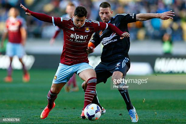 Nikola Petkovic of Sydney FC and Mauro Zarate of West Ham contest the ball during the Football United New Zealand Tour match between Sydney FC and...