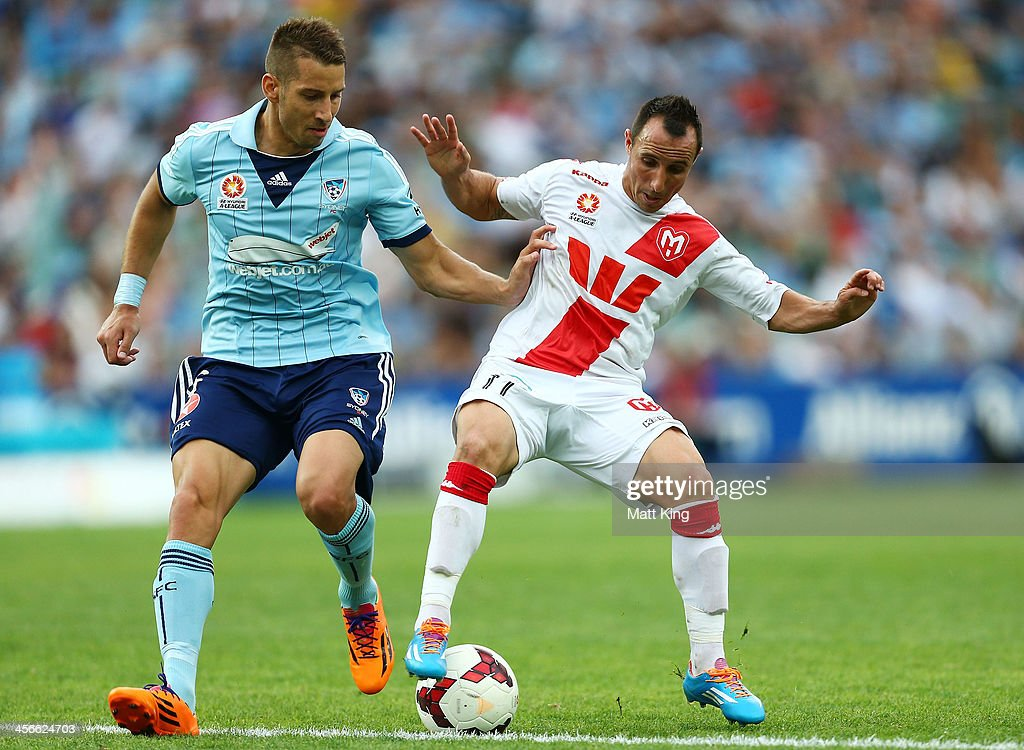 Nikola Petkovic of Sydney FC competes with Michael Mifsud of the Heart during the round 10 A-League match between Sydney FC and the Melbourne Heart at Allianz Stadium on December 15, 2013 in Sydney, Australia.