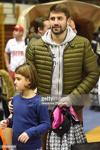 Nikola Radjen waterpolo serbian former player with his daughter attends the 2016/2017 Turkish Airlines EuroLeague Regular Season Round 12 game...