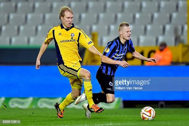 Nikola Storm of Club Brugge is fouled by Valtteri Moren of HJK Helsinki during the UEFA Europa League group B match between between Club Brugge and...