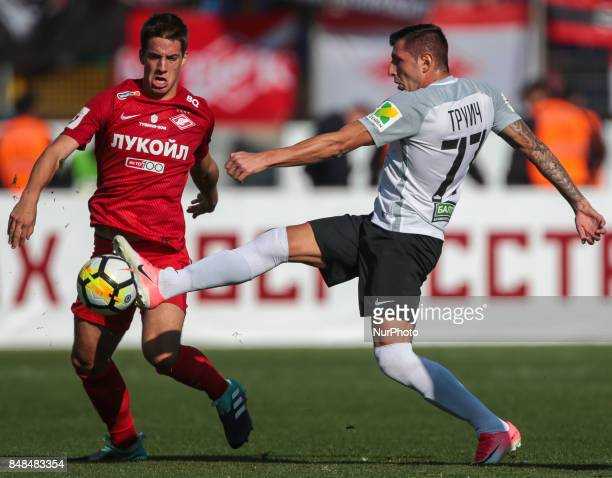Nikola Trujic of FC Tosno and Mario Pasalic of FC Spartak Moscow vie for the ball during the Russian Football League match between FC Tosno and FC...