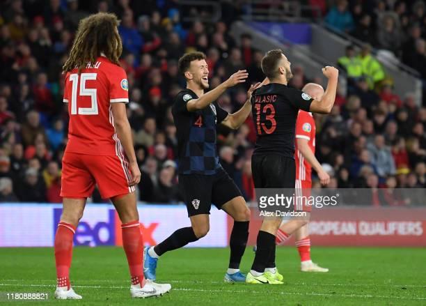 Nikola Vlasic of Croatia celebrates scoring his teams first goal with Ivan Perisic during the UEFA Euro 2020 qualifier between Wales and Croatia at...
