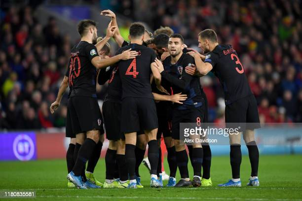Nikola Vlasic of Croatia celebrates with teammates after scoring the opening goal during the UEFA Euro 2020 qualifier between Wales and Croatia at...