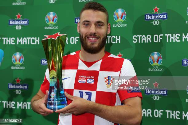 """Nikola Vlasic of Croatia poses for a photograph with the Heineken """"Star of the Match"""" award after the UEFA Euro 2020 Championship Group D match..."""