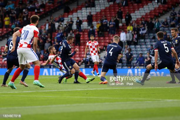 Nikola Vlasic of Croatia scores their side's first goal whilst under pressure from Callum McGregor of Scotland during the UEFA Euro 2020 Championship...