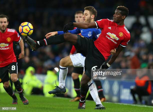 Nikola Vlasic of Everton and Paul Pogba of Manchester United in action during the Premier League match between Everton and Manchester United at...