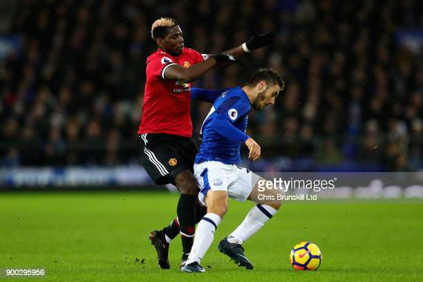 Nikola Vlasic of Everton is challenged by Paul Pogba of Manchester United during the Premier League match between Everton and Manchester United at...