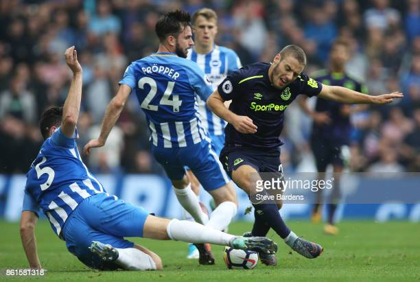 Nikola Vlasic of Everton is tackled by Lewis Dunk of Brighton and Hove Albion during the Premier League match between Brighton and Hove Albion and...