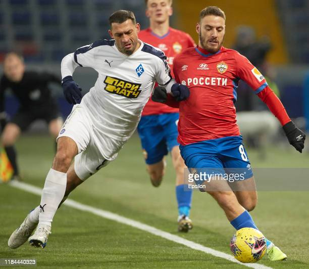 Nikola Vlasic of PFC CSKA Moscow and Alexandru Gacan of FC Krylia Sovetov Samara vie for the ball during the Russian Football League match between...