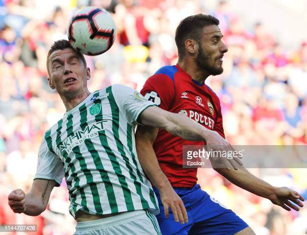 Nikola Vlasic of PFC CSKA Moscow and Andrei Semyonov of FC Akhmat Grozny vie for the ball during the Russian Football League match between PFC CSKA...