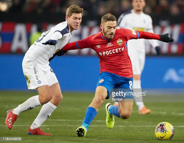 Nikola Vlasic of PFC CSKA Moscow and Artyom Timofeyev of FC Krylia Sovetov Samara vie for the ball during the Russian Football League match between...