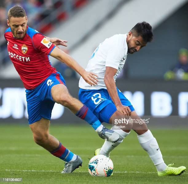 Nikola Vlasic of PFC CSKA Moscow and Christian Noboa of FC Sochi vie for the ball during the Russian Football League match between PFC CSKA Moscow...