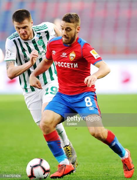 Nikola Vlasic of PFC CSKA Moscow and Oleg Ivanov of FC Akhmat Grozny vie for the ball during the Russian Football League match between PFC CSKA...