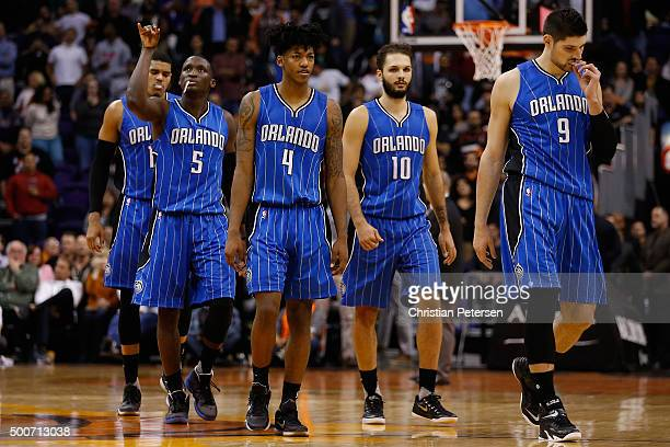 Nikola Vucevic Evan Fournier Elfrid Payton and Victor Oladipo of the Orlando Magic walk to the bench during a break in the final moments of the NBA...