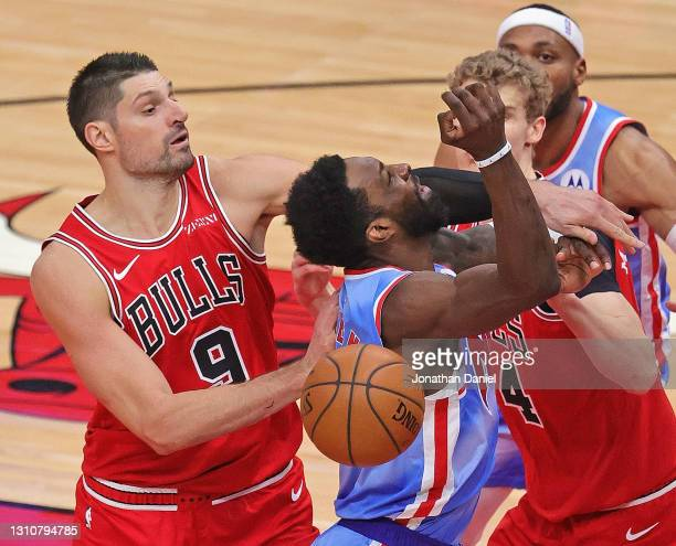 Nikola Vucevic of the Chicago Bulls fouls Jeff Green of the Brooklyn Nets at the United Center on April 04, 2021 in Chicago, Illinois. NOTE TO USER:...