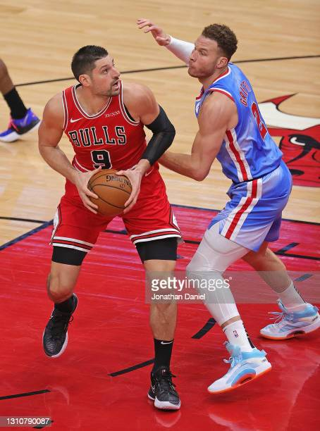 Nikola Vucevic of the Chicago Bulls moves against Blake Griffin of the Brooklyn Nets at the United Center on April 04, 2021 in Chicago, Illinois....