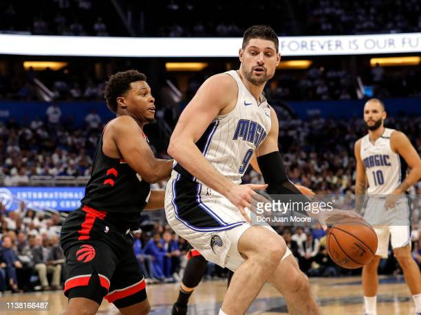 Nikola Vucevic of the Orlando Magic backs Kyle Lowry of the Toronto Raptors in the post during Game Three of the first round of the 2019 NBA Eastern...