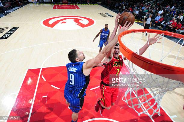 Nikola Vucevic of the Orlando Magic blocks a shot against the Atlanta Hawks on December 9 2017 at Philips Arena in Atlanta Georgia NOTE TO USER User...