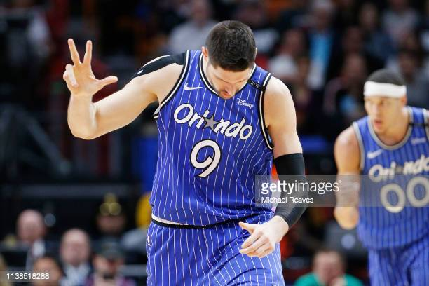 Nikola Vucevic of the Orlando Magic celebrates a three pointer against the Miami Heat in the second half at American Airlines Arena on March 26 2019...