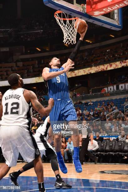 Nikola Vucevic of the Orlando Magic drives to the basket against the San Antonio Spurs on October 27 2017 at Amway Center in Orlando Florida NOTE TO...