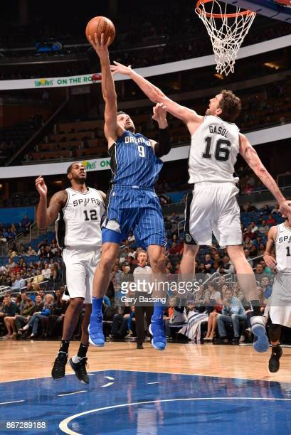 Nikola Vucevic of the Orlando Magic drives to the basket against the San Antonio Spurs on October 27, 2017 at Amway Center in Orlando, Florida. NOTE...