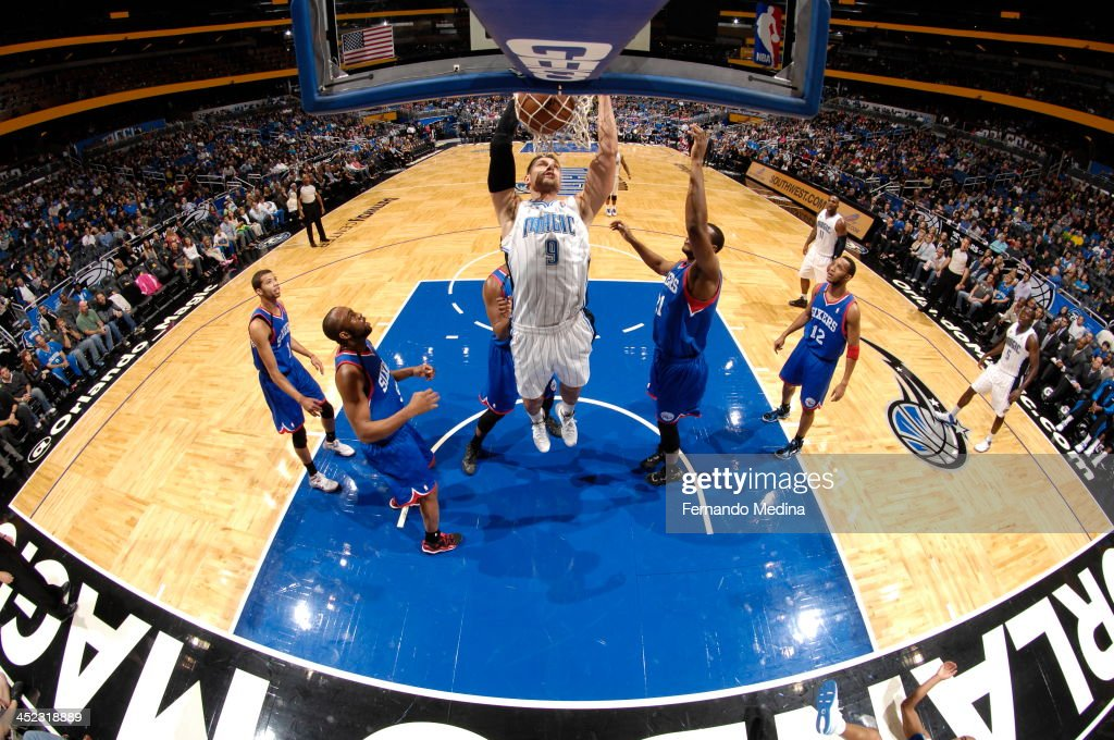 Nikola Vucevic #9 of the Orlando Magic goes up for the dunk against the Philadelphia 76ers during the game on November 27, 2013 at Amway Center in Orlando, Florida.