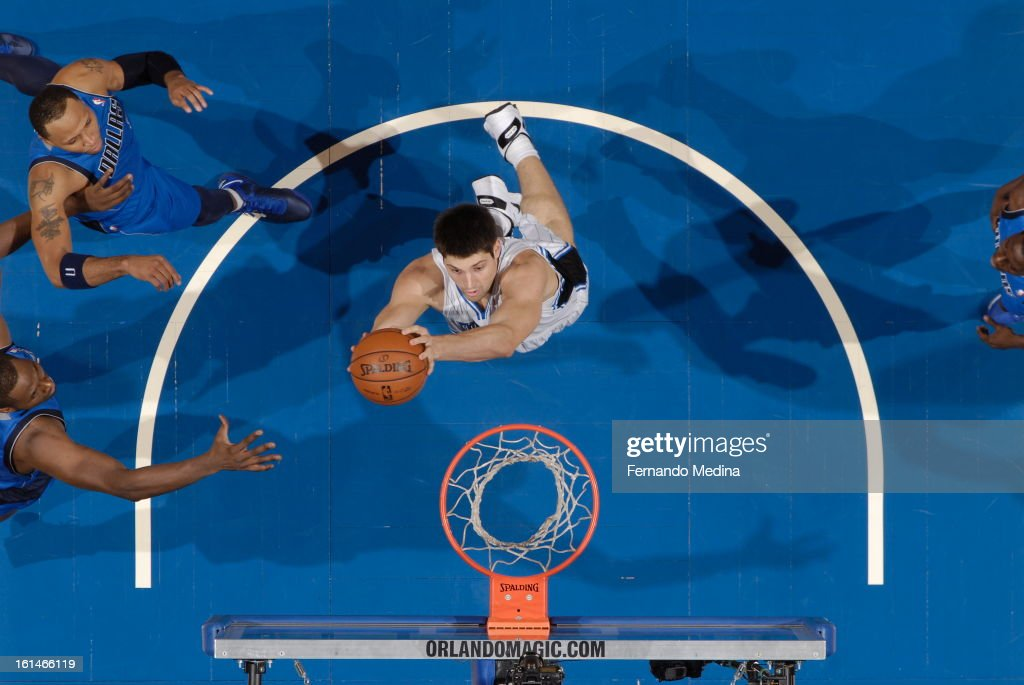 Nikola Vucevic of the Orlando Magic goes up for the layup against the Dallas Mavericks during the game on January 20, 2013 at Amway Center in Orlando, Florida.